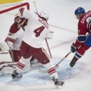 Montreal Canadiens' Alex Galchenyuk, right, scores on Arizona Coyotes goaltender Louis Domingue as Coyotes' Zbynek Michalek (4) defends during first period NHL hockey action in Montreal, Sunday, Feb. 1, 2015 The Associated Press