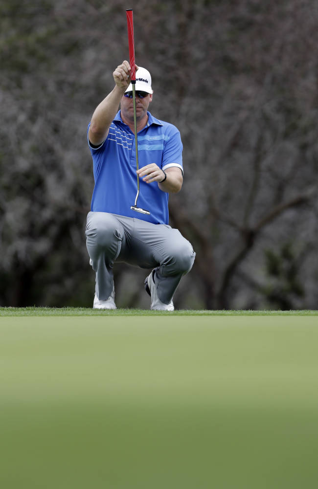 Justin Hicks lines up his putt on the 17th green during the second round of the Valero Texas Open golf tournament, Friday, March 28, 2014, in San Antonio