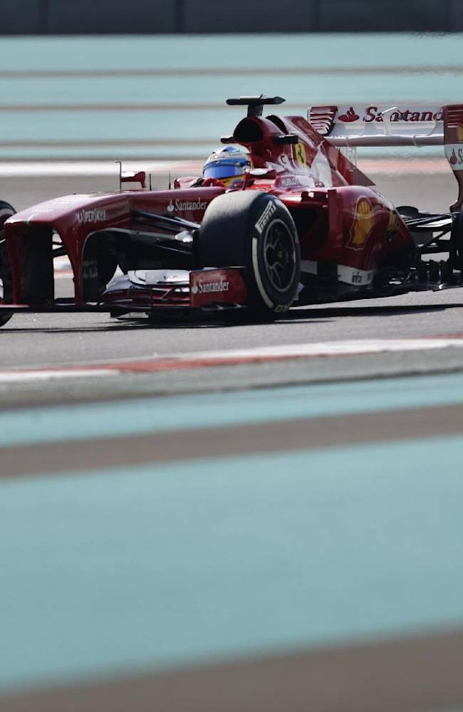 Ferrari driver Fernando Alonso of Spain steers his car during the first free practice at the Yas Marina racetrack in Abu Dhabi, United Arab Emirates, Friday, Nov. 1, 2013. The Emirates Formula One Grand Prix will take place on Sunday