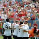 IMAGE DISTRIBUTED FOR GUINNESS INTERNATIONAL CHAMPIONS CUP - Wayne Rooney celebrates his first goal of the match with teammates of Manchester United at the Guinness International Champions Cup on Saturday, July 26, 2014 in Denver, Colo. Cricket Something