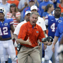 Florida's D.J. Durkin, the Linebackers/Special Teams Coordinator, reacts to a big play against Bowling Green during the second half of an NCAA college football game Saturday, Sept. 1, 2012, in Gainesville, Fla. Florida won 27-14. (AP Photo/John Raoux)