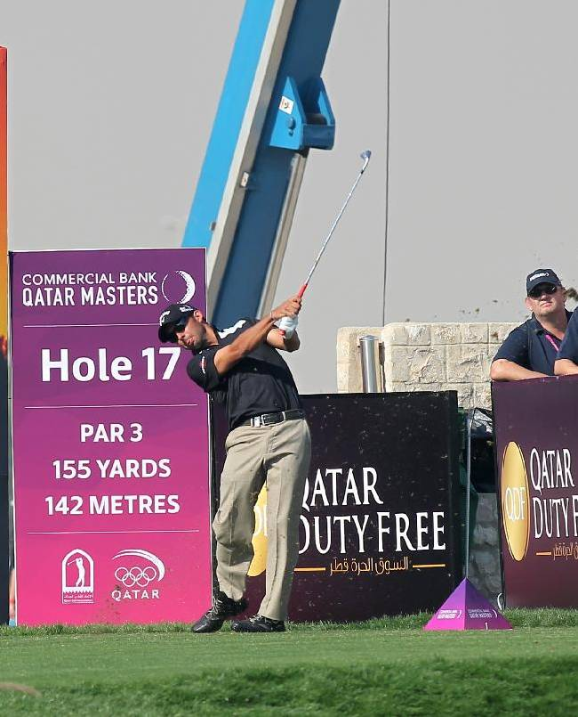 Pablo Larrazabal of Spain hits his tee shot on the 17 th hole during the second round of the Commercial Bank Qatar Masters at the Doha Golf Club in Doha, Qatar,Thursday, Jan. 23, 2014
