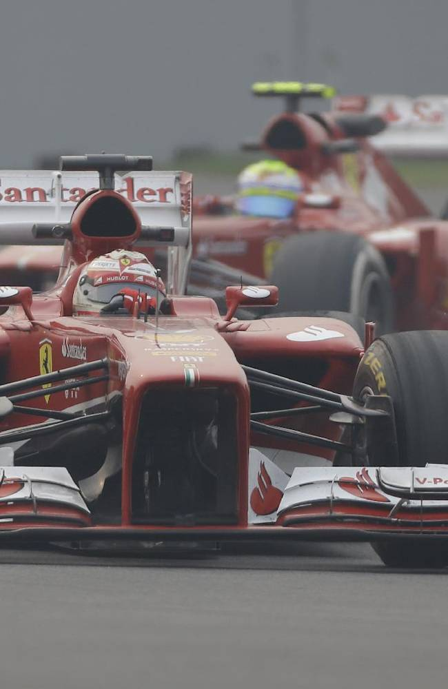 Ferrari driver Fernando Alonso of Spain leads teammate Felipe Massa of Brazil during the second practice session at the Indian Formula One Grand Prix at the Buddh International Circuit in Noida, India, Friday, Oct. 25, 2013
