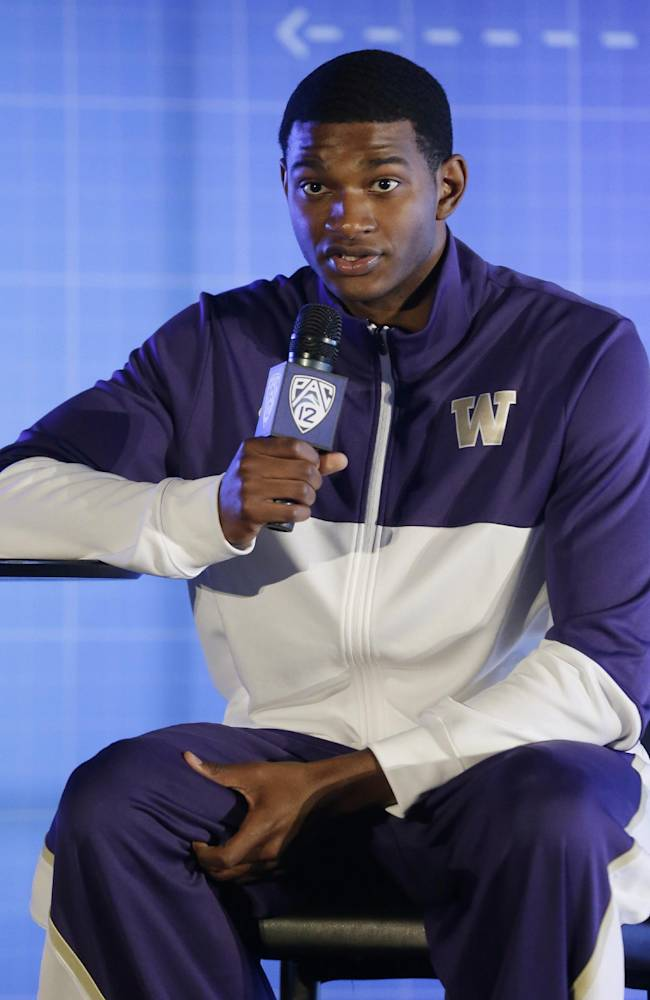 Washington's C.J. Wilcox answers questions during the Pac-12 NCAA college basketball media day, Thursday, Oct. 17, 2013, in San Francisco