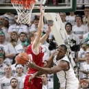 Michigan State's Derrick Nix, right, passes against Indiana's Cody Zeller during the first half of an NCAA college basketball game, Tuesday, Feb. 19, 2013, in East Lansing, Mich. (AP Photo/Al Goldis)