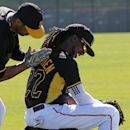 Pittsburgh Pirates' Andrew McCutchen, right, gets worked over by non-roster invitee Chris Dickerson during a break in the action at the team's baseball spring training workout in Bradenton, Fla., Thursday, Feb. 20, 2014 The Associated Press