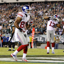 In this Sept. 30, 2012, file photo, New York Giants wide receiver Victor Cruz (80) does a Salsa dance as he celebrates his touchdown against the Philadelphia Eagles during an NFL football game in Philadelphia. Celebrations that used to be part of the game
