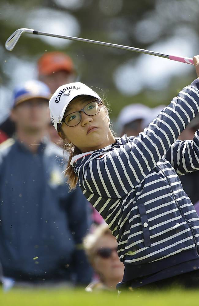 Lydia Ko, of New Zealand, follows her shot from the third tee of the Lake Merced Golf Club during the third round of the Swinging Skirts LPGA Classic golf tournament on Saturday, April 26, 2014, in Daly City, Calif