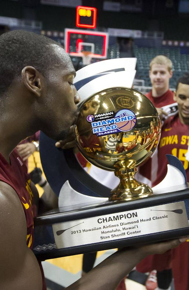 Iowa State forward Dustin Hogue gives the Diamond Head Classic championship trophy a kiss after Iowa State defeated Boise State in an NCAA college basketball game Wednesday, Dec. 25, 2013, in Honolulu. Iowa State won 70-66