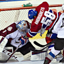 Montreal Canadiens' Sven Andrighetto (58) pushes Colorado Rockies goalie Semyon Varlamov (1) during the first period of an NHL preseason hockey game Friday, Sept. 26, 2014, in Quebec City. The Associated Press