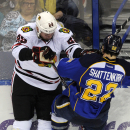 St. Louis Blues' Kevin Shattenkirk (22) collides with Chicago Blackhawks' Bryan Bickell (29) during the third period in Game 2 of a first-round NHL hockey playoff series, Saturday, April 19, 2014, in St. Louis The Associated Press