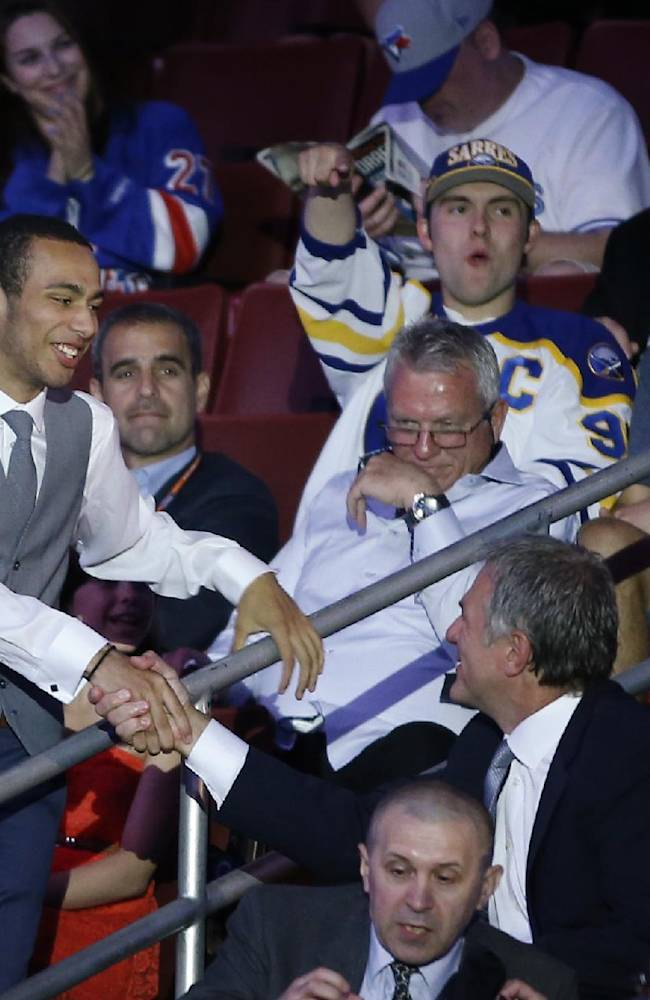 Joshua Ho-Sang walks to the stage after being chosen 28th overall by the New York Islanders during the first round of the NHL hockey draft, Friday, June 27, 2014, in Philadelphia