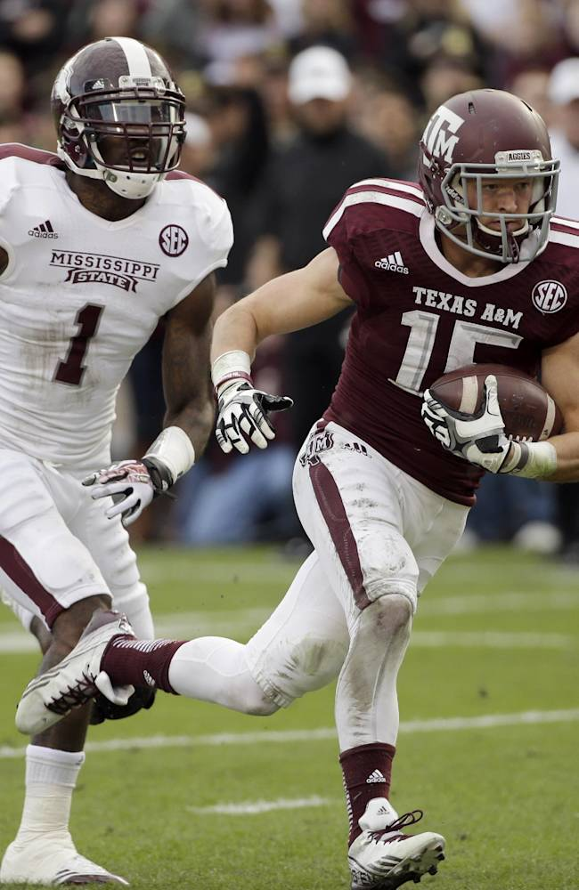Texas A&M wide receiver Travis Labhart (15) runs into the end zone for a touchdown after catching a pass as Mississippi State defensive back Nickoe Whitley (1) defends during the second quarter of an NCAA college football game Saturday, Nov. 9, 2013, in College Station, Texas