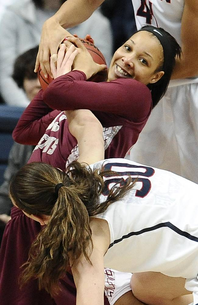 Saint Joseph's Ashley Robinson, center facing, is pressured from Connecticut's Kiah Stokes, top and Breanna Stewart, bottom, during the first half of a second-round game of the NCAA women's college basketball tournament, Tuesday, March 25, 2014, in Storrs, Conn. (AP Photo/Jessica Hill)