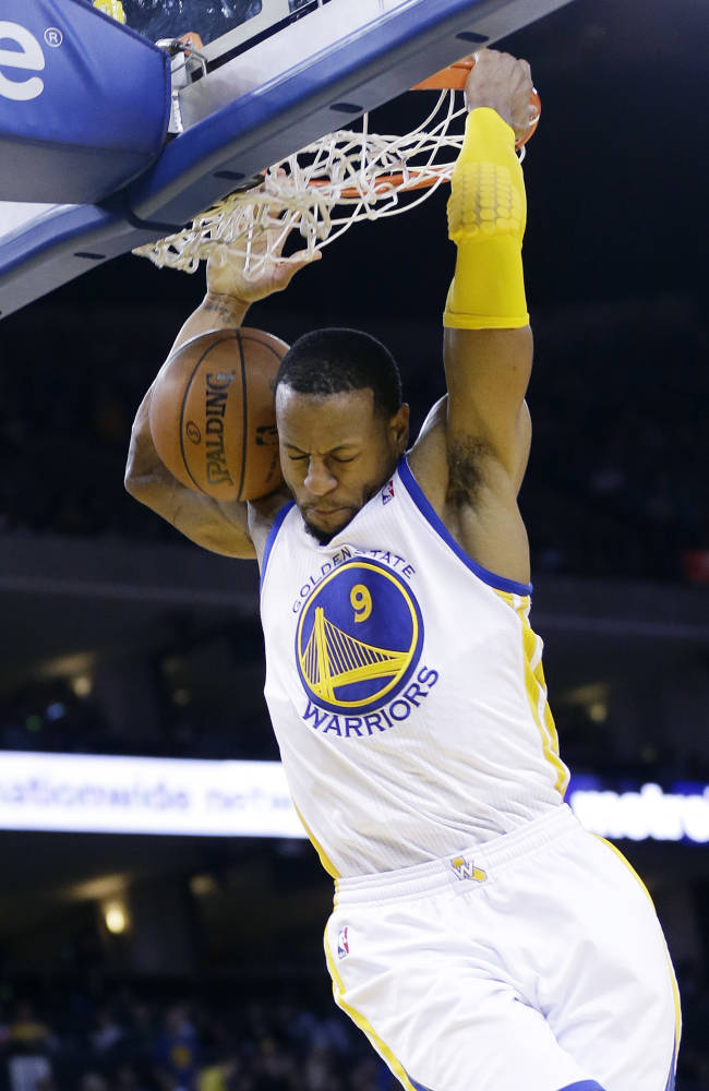 Golden State Warriors' Andre Iguodala dunks against the Portland Trail Blazers during the second half of an NBA basketball game on Sunday, Jan. 26, 2014, in Oakland, Calif. Golden State won 103-88