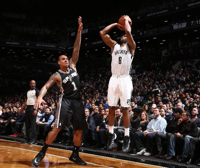 Nets pull away to beat short-handed Spurs, 103-89