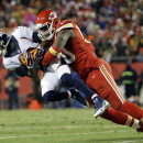 FILE - In this Nov. 30, 2014, file photo, Denver Broncos wide receiver Emmanuel Sanders, left, is tackled by Kansas City Chiefs outside linebacker Justin Houston in the first half of an NFL football game in Kansas City, Mo. The Chiefs have placed the franchise tag on All-Pro pass rusher Justin Houston, a person familiar with the decision tells The Associated Press. The person spoke on condition of anonymity Monday, March 2, 2015, because the Chiefs have not announced the move. (AP Photo/Charlie Riedel, File)