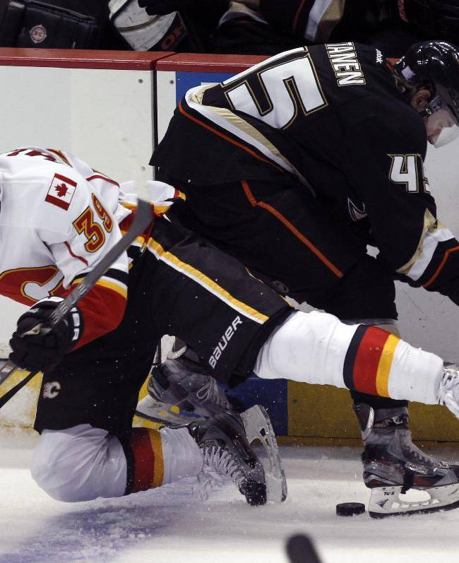 Calgary Flames goalie Karri Ramo (31), of Finland,  collides into Anaheim Ducks defenseman Sami Vatanen (45), of Finland, battling for the puck during the third period of an NHL hockey game, Wednesday, Oct. 16, 2013, in Anaheim, Calif. Ducks won the game 3-2