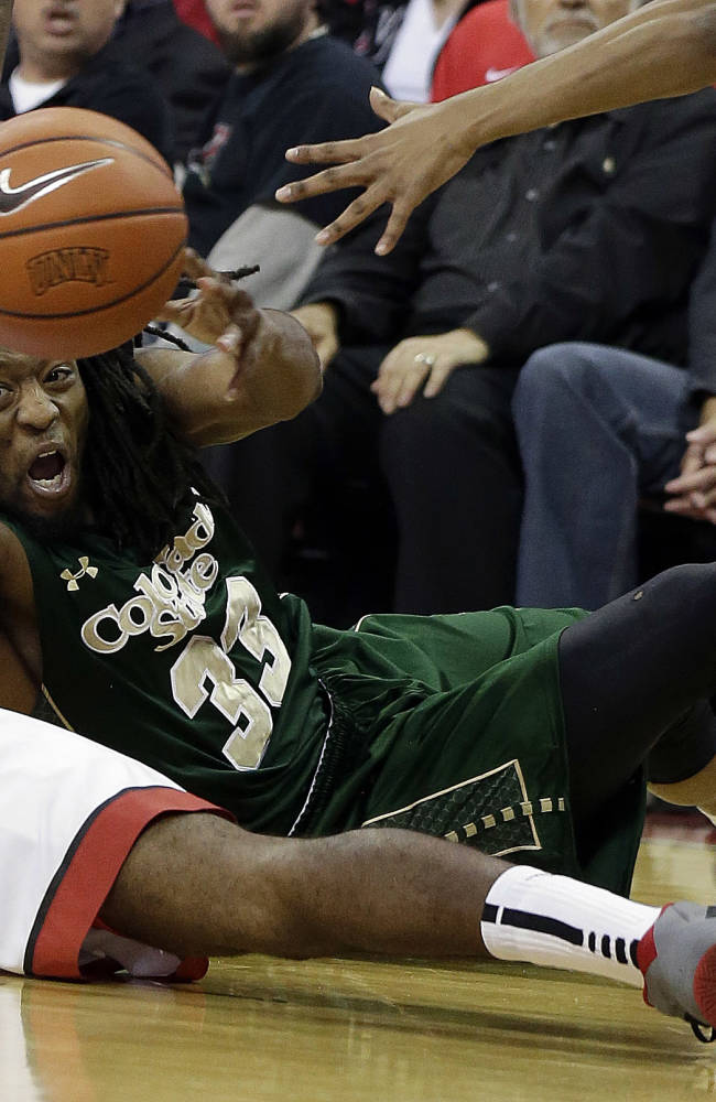 Colorado State's Dwight Smith passes the ball from the court covered by UNLV's Roscoe Smith during the first half of an NCAA college basketball game on Wednesday, Feb. 26, 2014, in Las Vegas