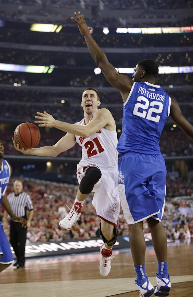 Wisconsin guard Josh Gasser, left, drives to the basket past Kentucky forward Alex Poythress during the first half of an NCAA Final Four tournament college basketball semifinal game Saturday, April 5, 2014, in Arlington, Texas