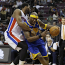 Detroit Pistons center Andre Drummond reaches in and fouls Golden State Warriors center Jermaine O'Neal (7) during the second half of an NBA basketball game in Auburn Hills, Mich., Monday, Feb. 24, 2014 The Associated Press