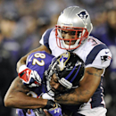 In this Dec. 22, 2013 file photo, Baltimore Ravens wide receiver Torrey Smith (82) is tackled by New England Patriots cornerback Aqib Talib in the second half of an NFL football game, in Baltimore. The Broncos spent the first day of free agency bolstering