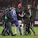 Didier Drogba of Galatasaray, center, and Frank Lampard of Chelsea after their Champions League Round of 16, First Leg match between Galatasaray and Chelsea at Turk Telekom Arena Stadium in Istanbul, Turkey, Wednesday, Feb. 26, 2014. (AP Photo)