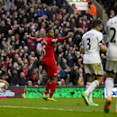 Liverpool's Daniel Sturridge, centre, celebrates after scoring his second goal against Swansea City during their English Premier League soccer match at Anfield Stadium, Liverpool, England, Sunday Feb. 23, 2014