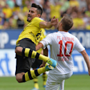 Augusburg's Daniel Baier, right, and Dortmund's Ilkay Guendogan are in action during the German first division Bundesliga soccer match between FC Augsburg and Borussia Dortmund in Augsburg, Germany, Saturday, Aug. 10, 2013. (AP Photo/Kerstin Joensson)