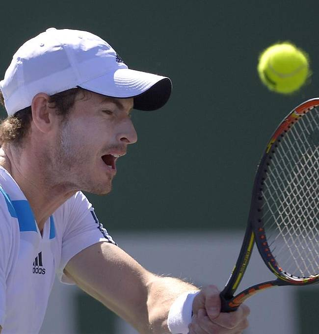 Andy Murray, of Great Britain, returns a shot against Milos Raonic, of Canada, during a fourth round match at the BNP Paribas Open tennis tournament, Wednesday, March 12, 2014, in Indian Wells, Calif