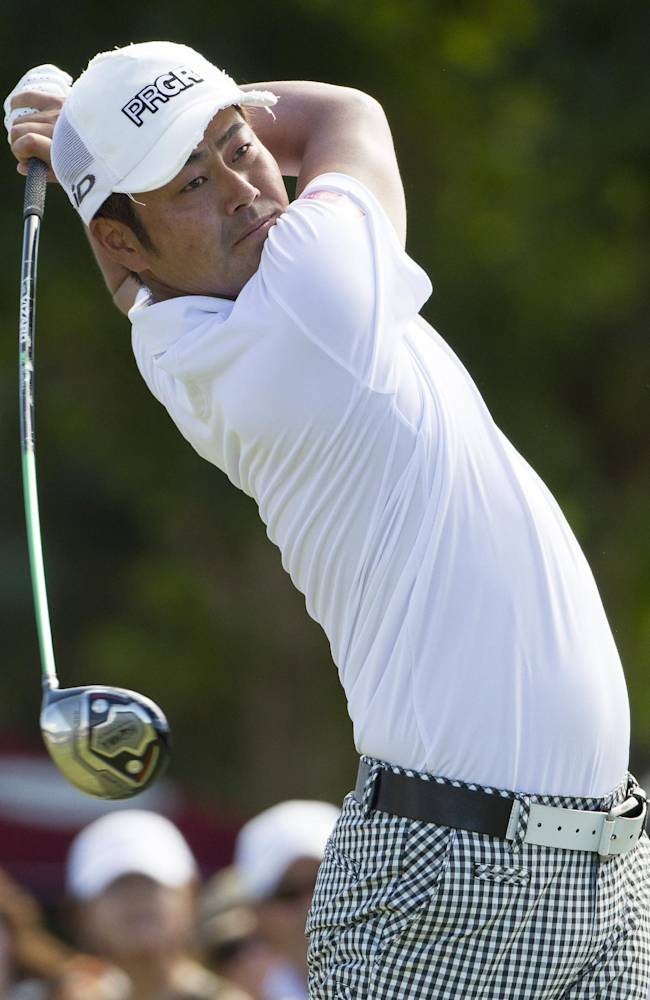 Hideto Tanihara, of Japan, watches his drive off the first tee during the fourth round of the Sony Open golf tournament at Waialae Country Club, Sunday, Jan. 12, 2014, in Honolulu