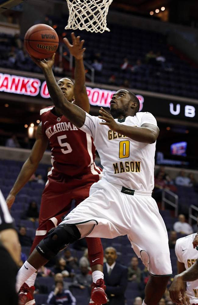CORRECTS TO SECOND HALF - George Mason guard Bryon Allen (0) shoots in front of Oklahoma guard Je'lon Hornbeak (5) during the second half of an NCAA college basketball game in the BB&T Classic, Sunday, Dec. 8, 2013, in Washington. Oklahoma won 81-66