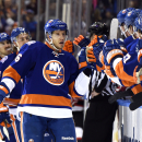 New York Islanders left wing Nikolay Kulemin (86) celebrates his goal against the New Jersey Devils with teammates in the first period of an NHL hockey game at Nassau Coliseum on Saturday, Nov. 29, 2014, in Uniondale, N.Y. The Islanders won 3-1 The Associ