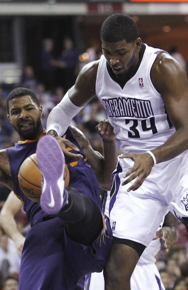Phoenix Suns forward Marcus Morris, left, and Sacramento Kings forward Jason Thompson struggle for the ball during the first quarter of an NBA preseason basketball game in Sacramento, Calif., Thursday, Oct. 17, 2013