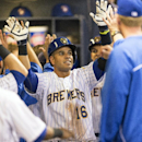Milwaukee Brewers' Aramis Ramirez is congratulated by teammates in the dugout after hitting a two-run home run off Pittsburgh Pirates' Francisco Liriano during the fourth inning of a baseball game on Friday, April 11, 2014, in Milwaukee The Associated Pre