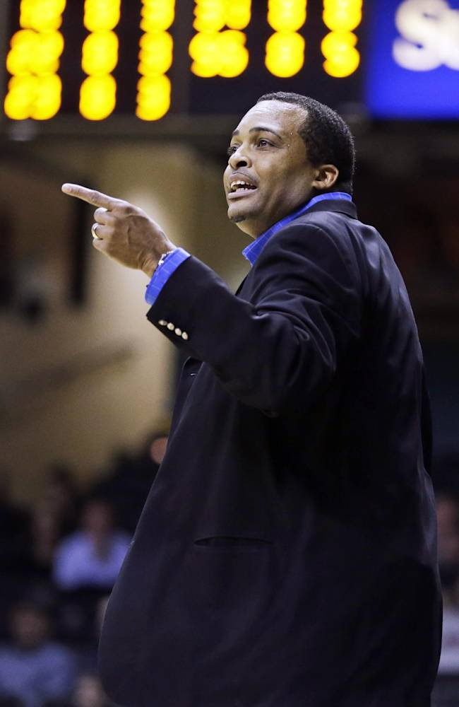 In this Nov. 12, 2013, file photo, Georgia State head coach Ron Hunter directs his team in the first half of an NCAA college basketball game against Vanderbilt in Nashville, Tenn. Hunter will coach Saturday in his bare feet, drawing attention to his real passion, providing shoes to millions of poor children around the world