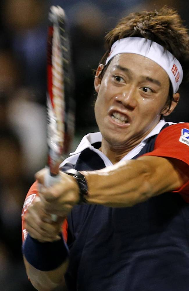 Kei Nishikori of Japan returns to Nicolas Almagro of Spain during the quarterfinal of the Japan Open Tennis Championships in Tokyo, Friday, Oct. 4, 2013