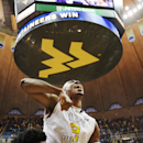 West Virginia guard Jevon Carter (2) celebrates after making both of his free-throws in overtime to defeat TCU 86-85 n an NCAA college basketball game, Saturday, Jan. 24, 2015, in Morgantown, W.Va. . (AP Photo/Raymond Thompson)