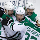 Dallas Stars' Colton Sceviour, Shawn Horcoff, Travis Morin and Alex Goligoski, fro left, celebrate Sceviour's goal against the Vancouver Canucks during the second period of an NHL hockey game Wednesday, Dec. 17, 2014, in Vancouver, British Columbia The As