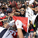 10ThingstoSeeSports - Fans scream as Houston Texans defensive end J.J. Watt, left, signs autographs after an NFL football training camp practice Thursday, Aug. 14, 2014, in Houston The Associated Press
