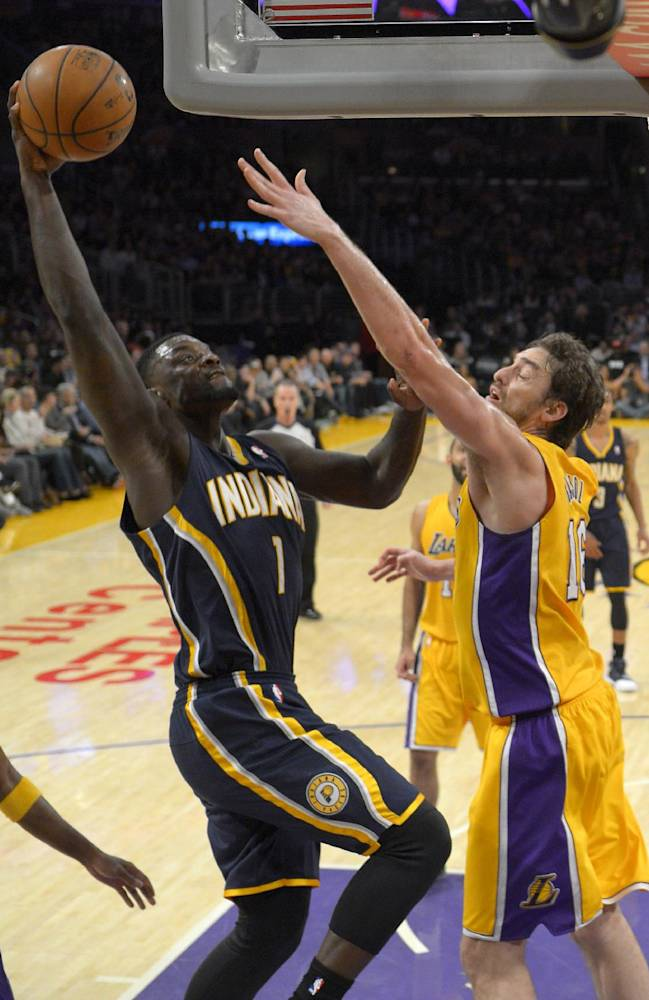 Indiana Pacers guard Lance Stephenson, left, pus up a shot as Los Angeles Lakers center Pau Gasol, of Spain, defends during the second half of an NBA basketball game, Tuesday, Jan. 28, 2014, in  Los Angeles