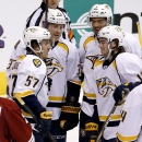 Nashville Predators' Calle Jarnkrok (19), of Sweden, celebrates his goal against the Arizona Coyotes with teammates Mattias Ekholm (14), of Sweden, Gabriel Bourque (57), Colin Wilson (33) and Seth Jones (3) as Coyotes' Lauri Korpikoski (28), of Finland, l