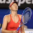 Maria Sharapova of Russia reacts to a lost point to Serena Williams of the U.S. during the women's singles final at the Australian Open tennis championship in Melbourne, Australia, Saturday, Jan. 31, 2015. (AP Photo/Rob Griffith)