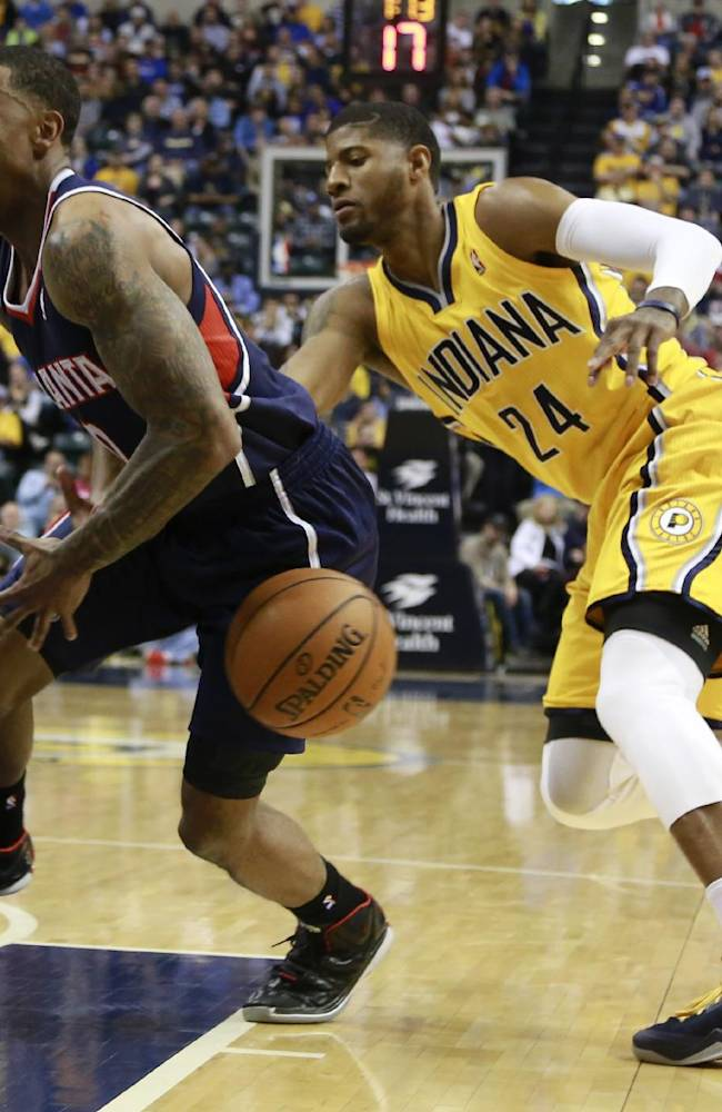 Indiana Pacers forward Paul George (24) tips the basketball away from Atlanta Hawks guard Jeff Teague in the first half of an NBA basketball game in Indianapolis, Sunday, April 6, 2014