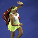 Victoria Azarenka of Belarus leaves after her fourth round loss to Dominika Cibulkova of Slovakia at the Australian Open tennis championship in Melbourne, Australia, Monday, Jan. 26, 2015. (AP Photo/Bernat Armangue)