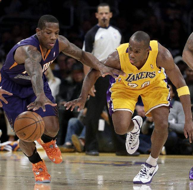 Phoenix Suns guard Eric Bledsoe, left, and Los Angeles Lakers guard Jodie Meeks chase a loose ball during the first half of an NBA basketball game in Los Angeles, Tuesday, Dec. 10, 2013
