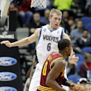 Cleveland Cavaliers' C.J. Miles, front, looks for help as Minnesota Timberwolves' Robbie Hummel, of Spain, looms over him in the first quarter of an NBA basketball game Wednesday, Nov. 13, 2013, in Minneapolis The Associated Press