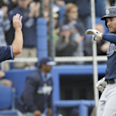 Tampa Bay Rays' Kevin Kiermaier, right, celebrates with teammate Jayson Nix after hitting a home run during the fourth inning of an exhibition baseball against the Toronto Blue Jays game Friday, March 7, 2014, in Dunedin, Fla The Associated Press