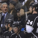Los Angeles Kings coach Darryl Sutter, left, comments to center Colin Fraser (24) in the first period during Game 5 of the We