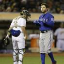 Texas Rangers' Ian Kinsler, right, tosses his helmet after striking out to Oakland Athletics' Sean Doolittle in the seventh inning of a baseball game Tuesday, May 14, 2013, in Oakland, Calif. (AP Photo/Ben Margot)